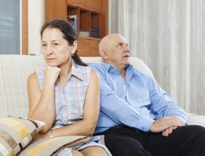 Mature woman having conflict with  senior husband